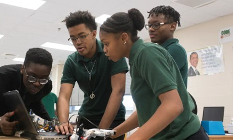 Students work on a project in a computer science principles course.