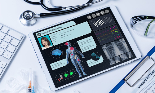 Tablet with patient's vital signs and medical history on screen