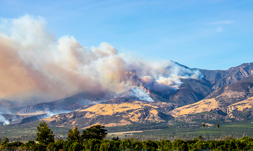 Smoke coming from a wildfire in the hills of Ventura County, California