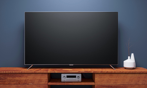 Smart tv on wooden console table