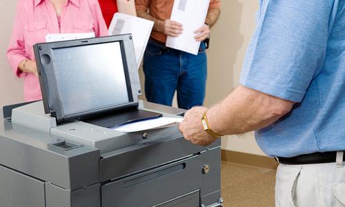 Man using a voting machine